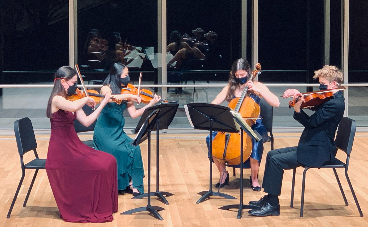 Lumiere Quartet - from left, two young women playing violin, one young woman playing cello and one young man playing viola