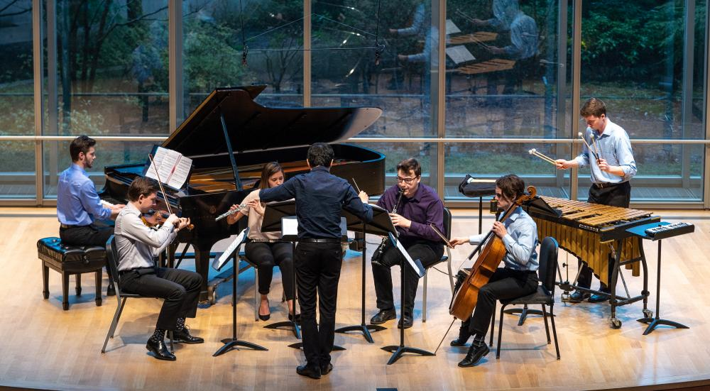 CIM New Music Ensemble, in this photo with piano, violin, flute, clarinet, cello, percussion and a conductor.