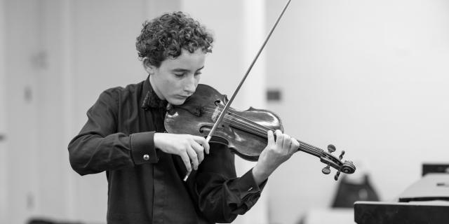 Young Artist Program student plays violin
